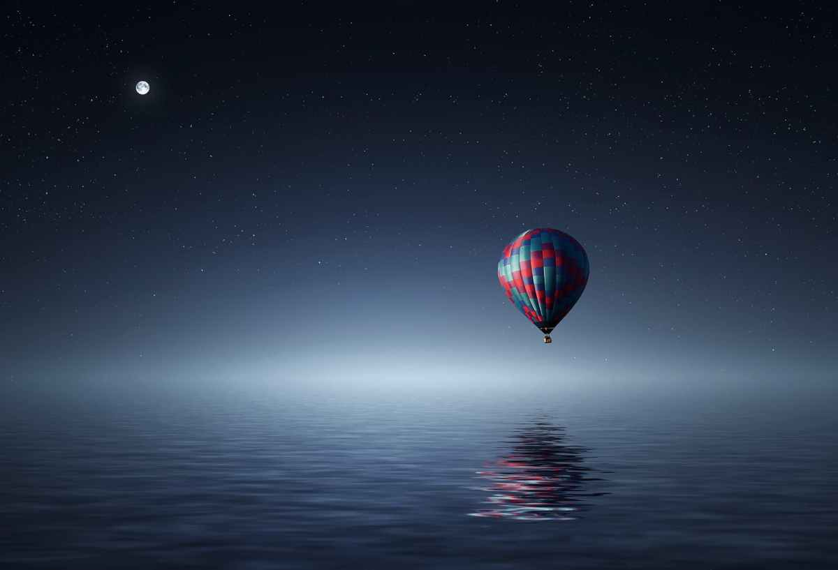 Balloon hovering above water
