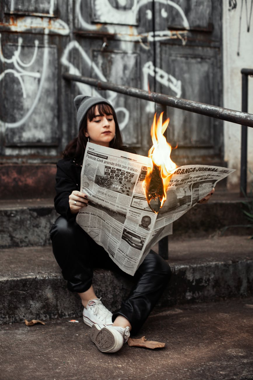 Image woman with burning paper